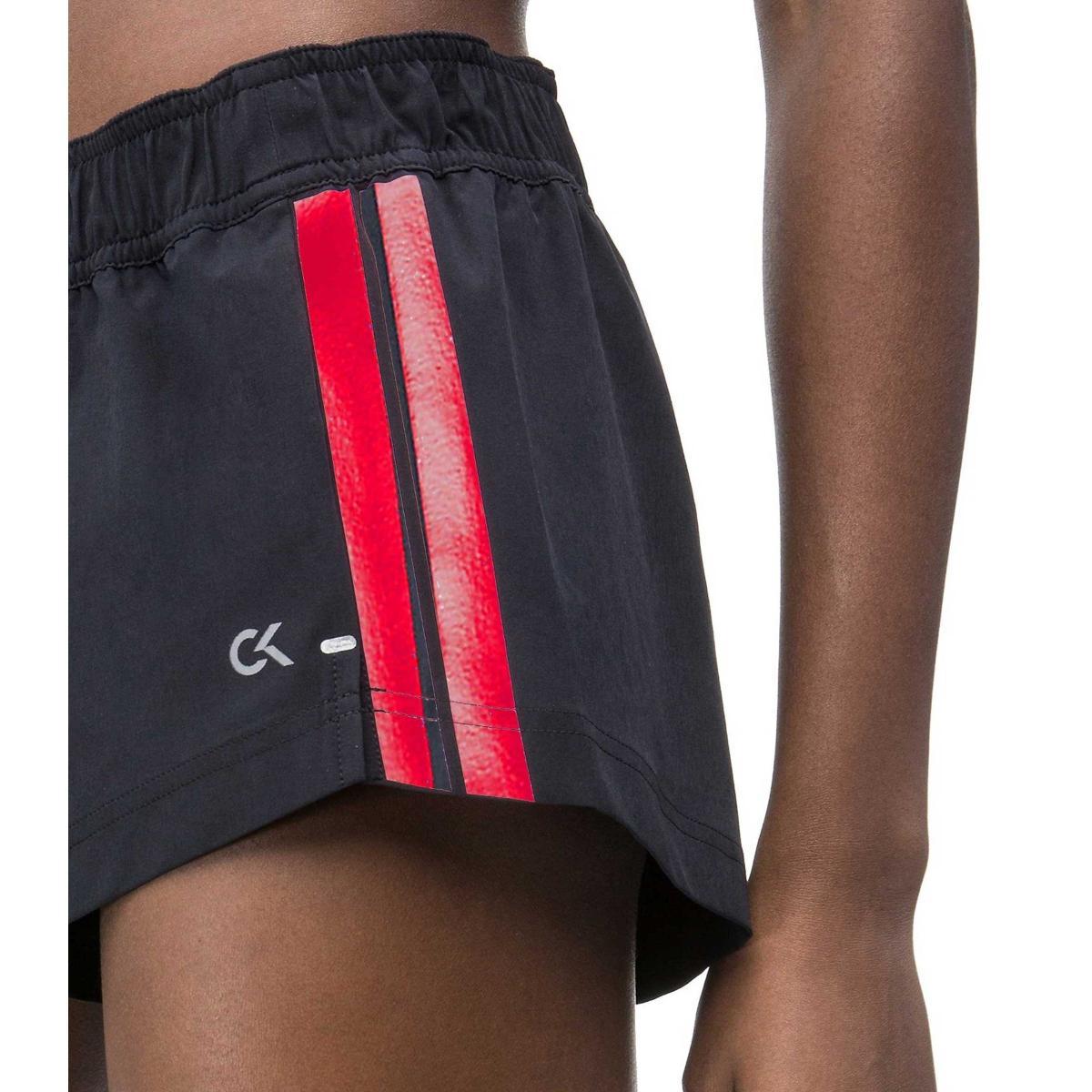 Pantaloncini shorts Calvin Klein Performance con bande laterali da donna rif. 00GWS9S858